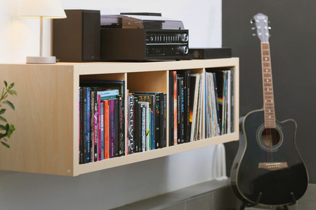 Books, LPs, turntable and guitar